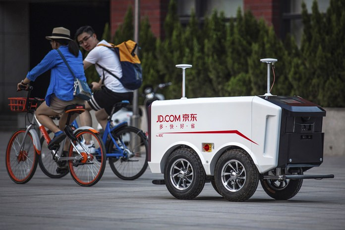 This undated image provided by JD.com shows an autonomous delivery vehicle. (JD.com via AP)