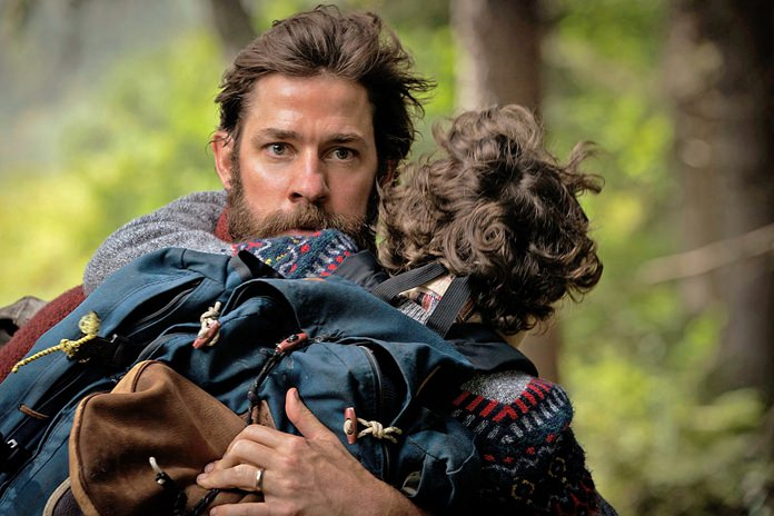 """This image shows actor-director John Krasinski im a scene from """"A Quiet Place,"""" with Noah Jupe. (Jonny Cournoyer/Paramount Pictures via AP)"""