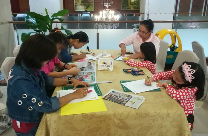 Mothers and their children enjoy making greeting cards at the workshop.