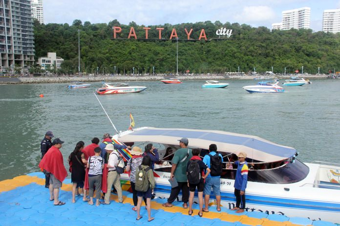 Tourists gather on the pontoon ready to board their speedboats for a day out on the islands.