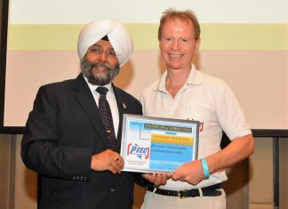 Ren Lexander presents Dr. Kamal Singh the PCEC's Certificate of Appreciation for his informative talk.