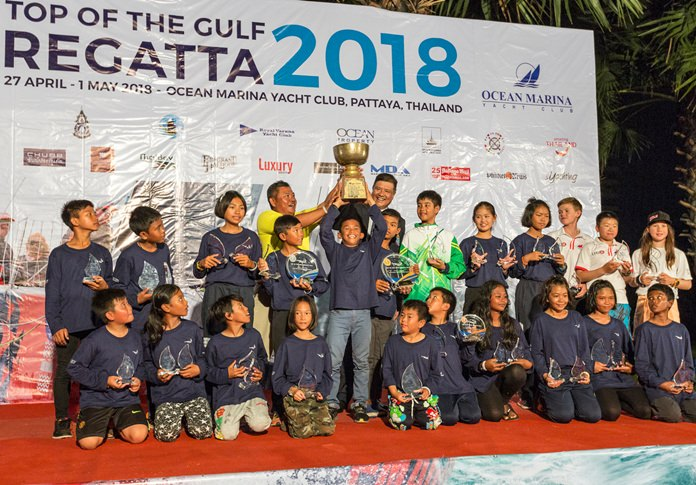 Youngster Panwa Boonak raises the trophy after being crowned Thailand Optimist National Champion.