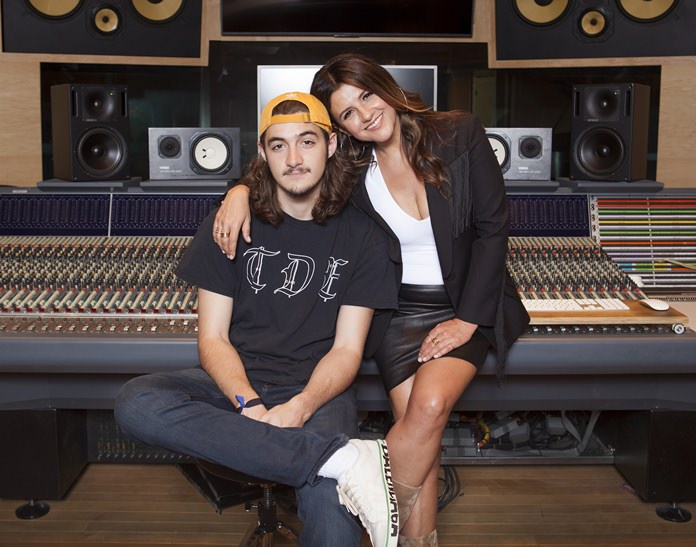 In this May 4, 2018 photo, Deacon Frey, son of the late Eagles co-founder Glenn Frey (left) and his mother Cindy Frey pose for a portrait at the Dog House Recording Studio in Los Angeles, California. (Photo by Rebecca Cabage/Invision/AP)