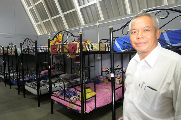 Palisorn Noja proudly shows off the sleeping quarters in the boys' house.