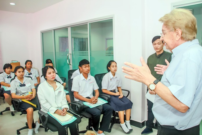 Hans Mueller explains to the children about how important their education is, for now and the future.
