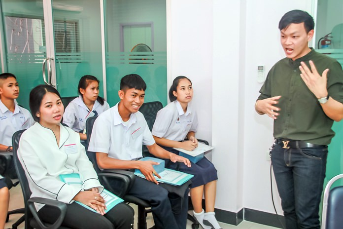 Natika Chuthong, 23 and Thanapol Chuthong, 15, listen intently as they are advised to strive for certain goals and objectives.