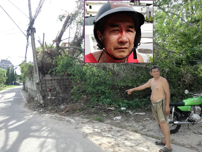 A resident points to the spot where a hapless motorcyclist (inset) got entangled in the sagging wires resulting in facial injuries.