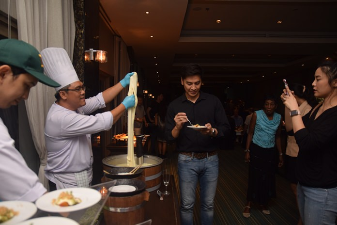 The chef delighted the guests with his inimitable technique of preparing cheese.