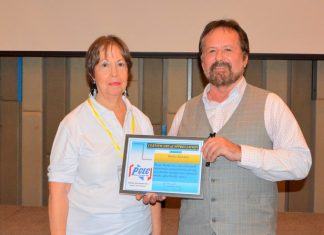MC Judith Edmonds presents the PCEC's Certificate of Appreciation to Stefan Sanchez for his informative and entertaining talk.