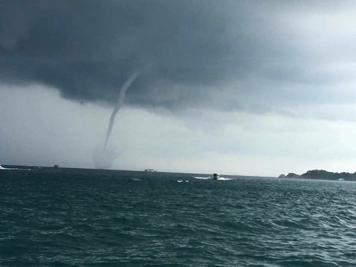 Waterspouts put on a spectacular show off Koh Larn Island.