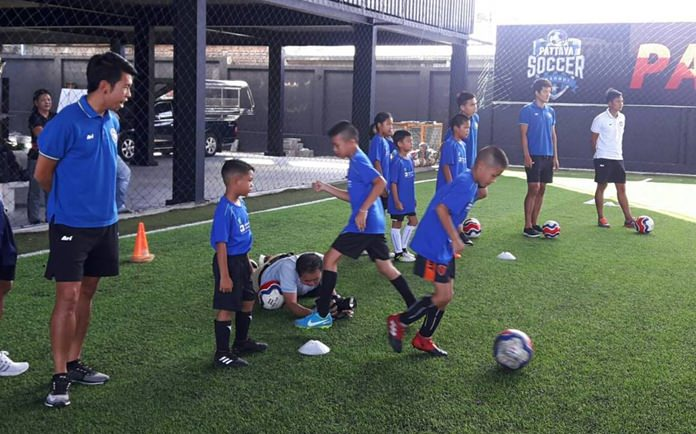 Kids were taught basic football techniques by coaches from Pattaya United.