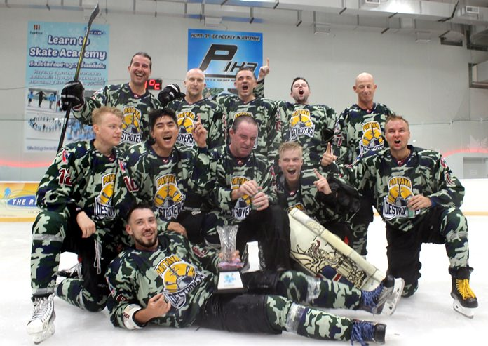 Pattaya Destroyers team members celebrate with the trophy after winning the Gulf of Siam Ice Hockey Classic at Harbor Mall in Pattaya, Saturday, May 19.
