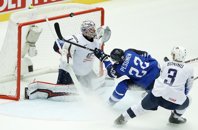 Finland's Janne Pesonen, center, fails to score past Keith Kinkaid, left, of the United States during the Ice Hockey World Championships in Herning, Denmark, Tuesday, May 15. (AP Photo/Petr David Josek)