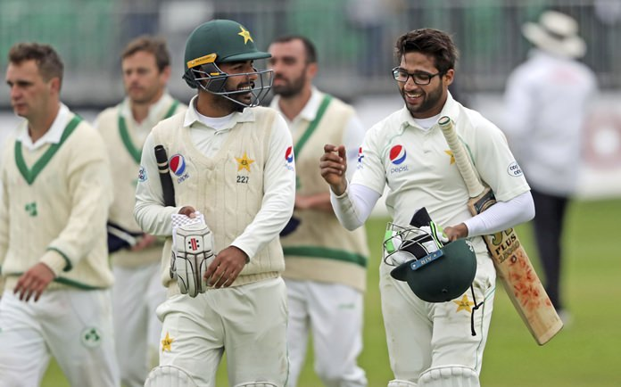 Pakistan's Shadab Khan and Imam Ul Haq, right, celebrate victory on day five against Ireland, at The Village, Dublin, Tuesday May 15. (Niall Carson/PA via AP)