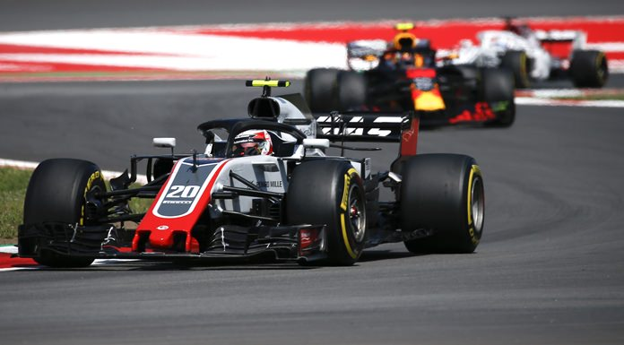Haas driver Kevin Magnussen of Denmark, left, steers his car during a free practice at the Barcelona Catalunya racetrack in Montmelo, just outside Barcelona, Spain, Friday, May 11. (AP Photo/Manu Fernandez)