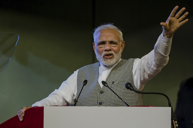 Indian Prime Minister Narendra Modi speaks during a function to inaugurate the Kishanganga hydropower station in Srinagar, Indian controlled Kashmir, Saturday, May 19. (AP Photo/Dar Yasin)