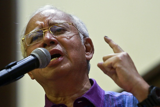 Former Malaysian Prime Minister Najib Razak gestures during his speech at United Malays National Organization (UMNO) building in Pekan, Malaysia, Sunday, May 20. (AP Photo/Sadiq Asyraf)