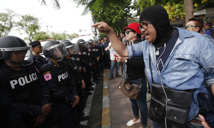 A pro-democracy protester shouts at police officers during a political gathering in Bangkok, Tuesday, May 22. (AP Photo/Sakchai Lalit)