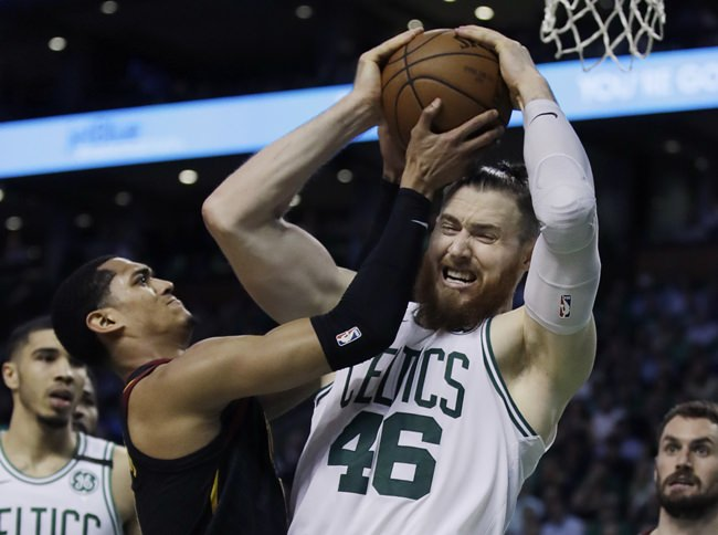 Boston Celtics center Aron Baynes (46) competes for a rebound against Cleveland Cavaliers guard Jordan Clarkson during the second quarter of Game 5 of the NBA basketball Eastern Conference finals Wednesday, May 23, in Boston. (AP Photo/Charles Krupa)
