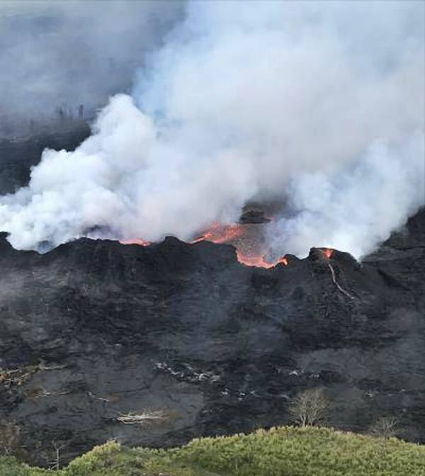 In this Saturday, May 26, 2018, image released by the U.S. Geological Survey HVO shows an aerial view of fissure 22 looking toward the south, as Kilauea Volcano continues its eruption cycle near Pahoa on the island of Kilauea, Hawaii. (U.S. Geological Survey via AP)