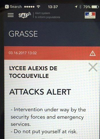 In this Thursday, March 16, 2017 file photo, a French police message alert of an attack at the Alexis de Tocqueville high school in the southern French town of Grasse is displayed on a cell phone in Paris. France's Interior Ministry has announced plans to beef up its danger alert system to the public across social media. (AP Photo, File)