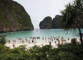Tourists crowd the beach at Maya Bay.