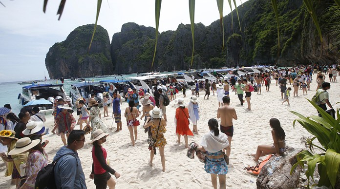 Tourists enjoy Maya Bay Beach on Phi Phi Leh. The government has set a limit of 2,000 tourists a day when the bay reopens.