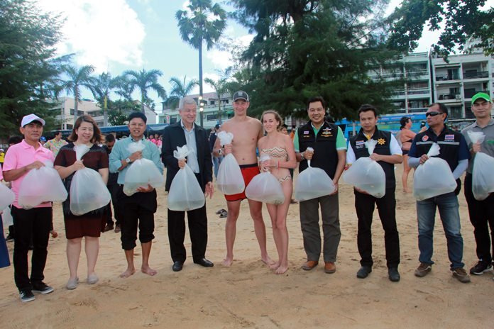 Tourists were invited to join the fun when city officials released 18,000 white seabass.