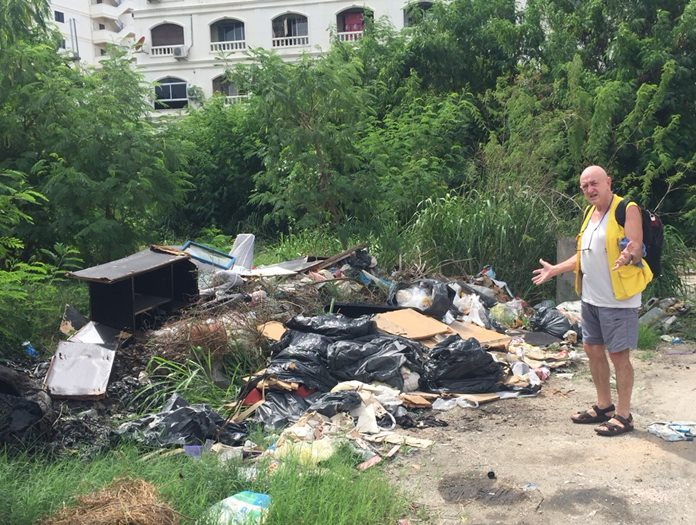 An expat resident in central Pattaya, who didn't provide his name, shows a reporter a large pile of waste on Soi Arunothai that has been ignored by the city for weeks.