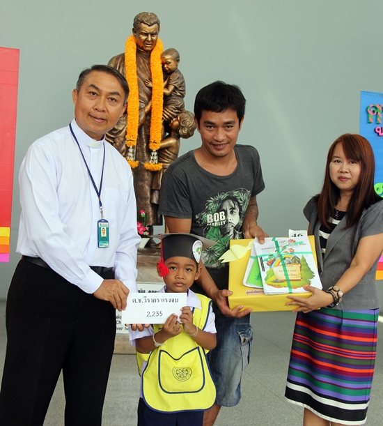 Father Peter presented certificates, a gift and cash to the graduates.