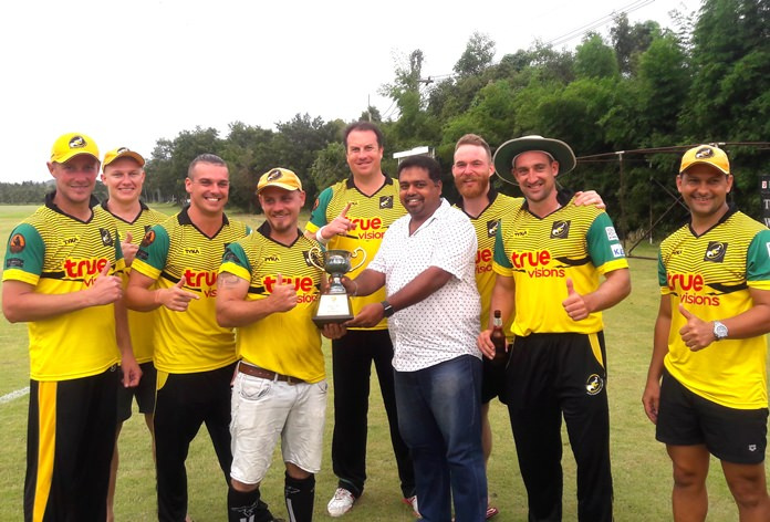 Southerners players pose with the Cup trophy after winning the Pattaya Super 8's cricket tournament at Thai Polo Club in Pattaya, Sunday, June 10.