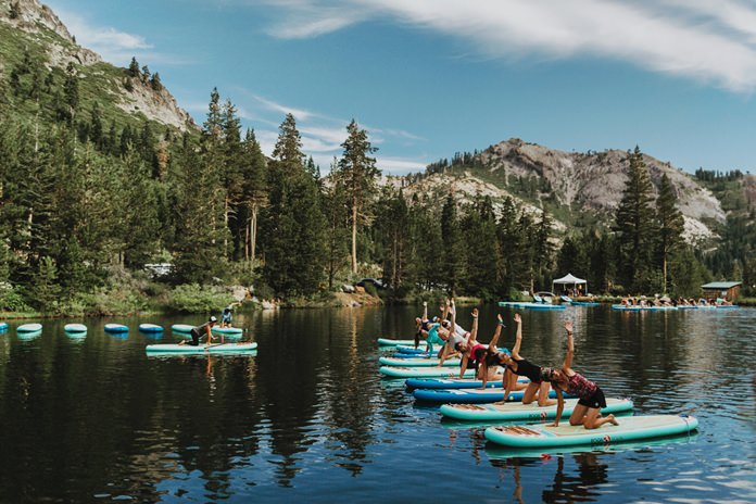 Participants work out on paddle boards during Wanderlust Squaw Valley 2017, in North Lake Tahoe, Calif. (Amanda Senior/Wanderlust via AP)