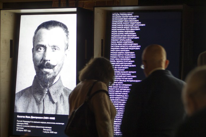 Visitors look at an exposition at the Gulag history museum in Moscow, Russia. (AP Photo/Alexander Zemlianichenko)