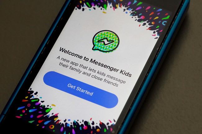 """Facebook is adding a """"sleep"""" mode to its Messenger Kids service so parents can limit how much time children spend on it. (AP Photo/Richard Drew, File)"""