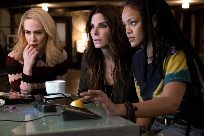 "This image released by Warner Bros. shows Sarah Paulson (from left) Sandra Bullock and Rihanna in a scene from ""Ocean's 8."" (Barry Wetcher/Warner Bros. via AP)"