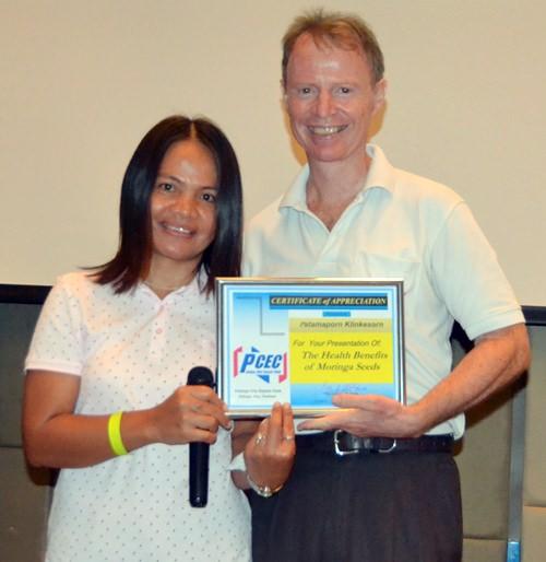 Member Ren Lexander presents Patmaporn klinkesorn with the PCEC's Certificate of Appreciation for her informative talk.