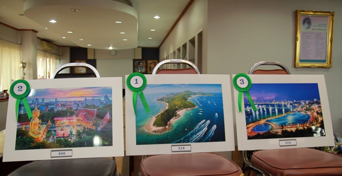 "The winning photo called ""Go To Koh Larn"" (center) with second place ""Land of Tradition"" and third place ""Pattaya by Night""."