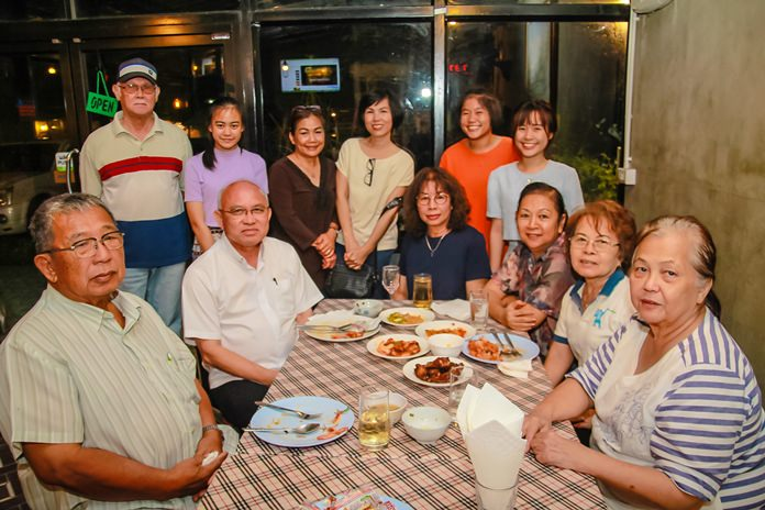 The Dibbayawan family and the Assumption Church congregation enjoying the party.