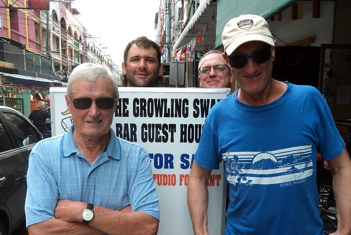 Paul Sharples (left) and Bill Steinmann (right), with Andy Zwart and Shaun McAlpine behind the sign.