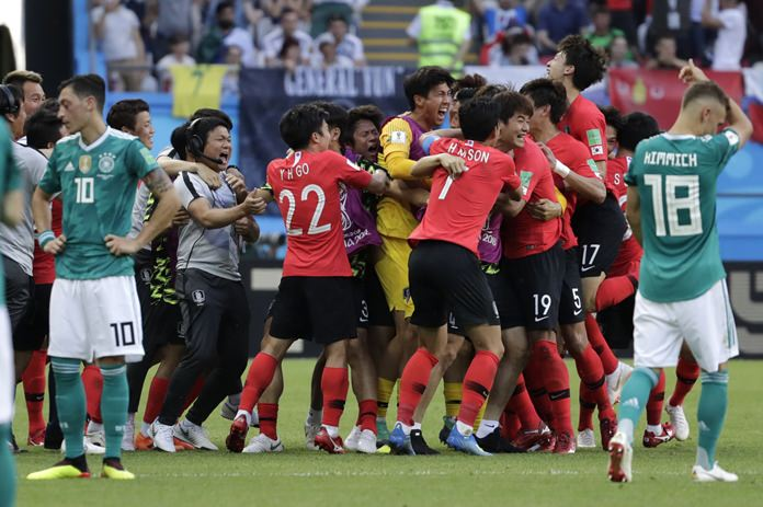 South Korea's players celebrate after beating Germany 2-0 at the 2018 soccer World Cup in the Kazan Arena in Kazan, Russia, Wednesday, June 27. (AP Photo/Lee Jin-man)