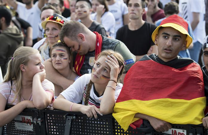 Soccer fans react after Germany was eliminated from the World Cup as they watch the group F World Cup match between South Korea and Germany as they visit the fan mile in Berlin Wednesday, June 27, 2018. (Bernd von Jutrczenka/dpa via AP)