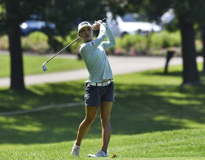 Lydia Ko, of New Zealand, hits her second shot on the ninth hole during the second round of the KPMG Women's PGA Championship golf tournament at Kemper Lakes Golf Club in Kildeer, Ill., Friday, June 29. (AP Photo/David Banks)