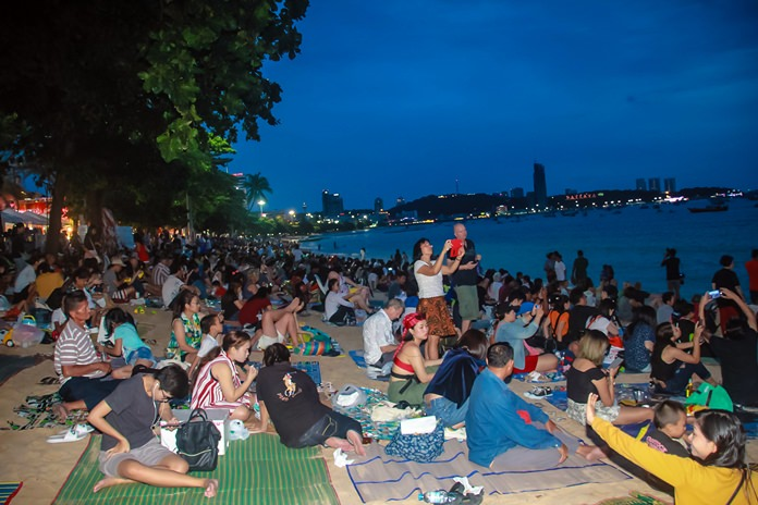 Pattaya Beach was jammed with couples, families and fireworks fans, many of whom brought along mats to stake out a place to sit and watch.