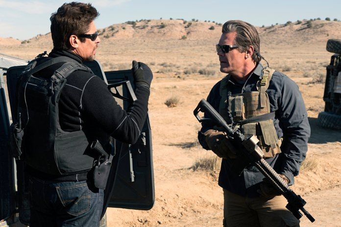 "This image shows Benicio Del Toro (left) and Josh Brolin in a scene from ""Sicario: Day of the Soldado."" (Richard Foreman, Jr./Sony Pictures via AP)"