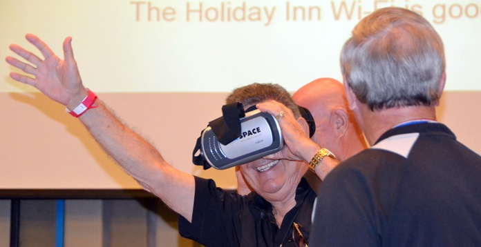 Jakob Friis before his presentation invited PCEC members and guests to try on some of the Virtual Reality goggles he brought with him to experience its wonders. Here, member Jim Johnson is thoroughly enjoying the experience.