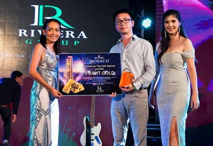 Sukanya presents a token of appreciation to top agent Mr. Nico Lou of Top Ocean Property.