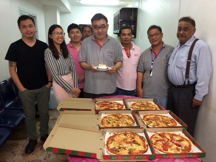 Longtime Pattaya Mail employee Manus Boonyakovit (center) celebrated both his birthday and a return to journalism with a party at the newspaper's office.
