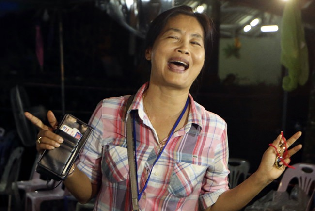 A family member smiles after hearing the news that the missing 12 boys and their soccer coach have been found. (AP Photo/Sakchai Lalit)