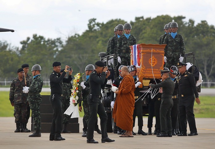 The body of Saman Gunan, a former Thai navy SEAL who died during an overnight mission, is carried during a repatriation and religious rites ceremony at Chiang Rai Airport in Mae Sai, Chiang Rai province, in northern Thailand Friday, July 6, 2018. The Thai navy diver working as part of the effort to rescue 12 boys and their soccer coach trapped in a flooded cave died Friday from lack of oxygen, underscoring risks of extracting the team. (AP Photo)