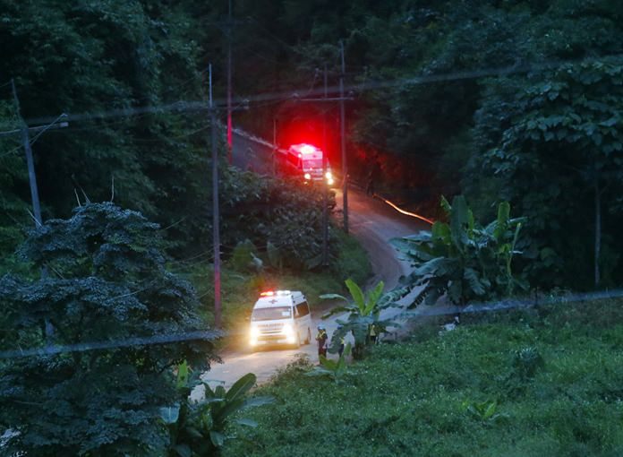 Two ambulances with flashing lights leave the cave rescue area. (AP Photo/Sakchai Lalit)